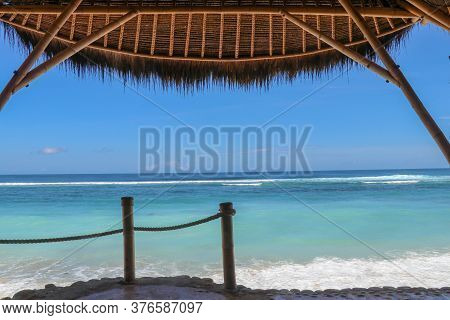 Outdoor Restaurant At The Beach. Cafe On The Beach, Ocean And Sky. View To Beach From Bar In Bali, I