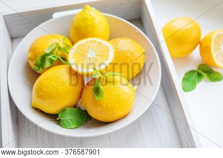 Wet Lemons And Mint In A Plate On A Tray. Ingredients For Cooling Homemade Lemonade.