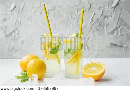 Two Foggy Glasses And A Decanter With Homemade Lemonade On The Table. Cooling Drink In The Hot Summe