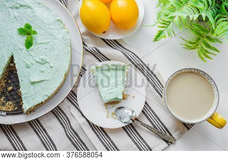 Mint Homemade Pie With Lemon Zest On A Striped Tablecloth. Summer Dessert On A White Table. Top View