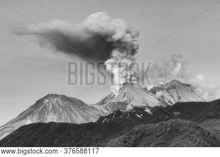 Mountain Landscape Of Kamchatka Peninsula, Dramatic View Of Eruption Of Zhupanovsky Volcano, Plume O