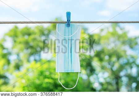 The Washed Protective Mask Is Dried On A Clothesline On A Sunny Summer Day. Humor.