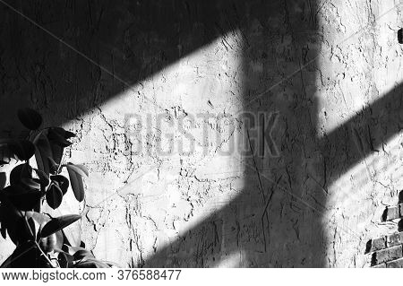 The Shadow Of The Window On The Textured Wall. Midday Hard Sunlight. Black And White.