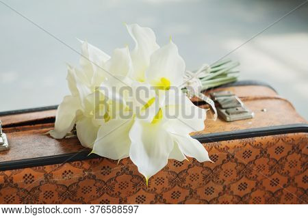 Bouquet Of White Callas On A Retro Suitcase. Meeting At The Station.