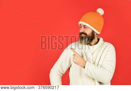 Winter Clothes And Accessories. Feeling Good. Hipster Style. Head In Warm Hat. Mature Emotional Hips