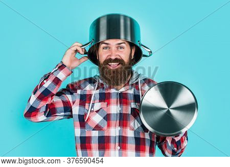 Feel Protected. Bearded Man Hold Kitchen Pan. Brutal Hipster Cooking With Saucepan. Housekeep Husban