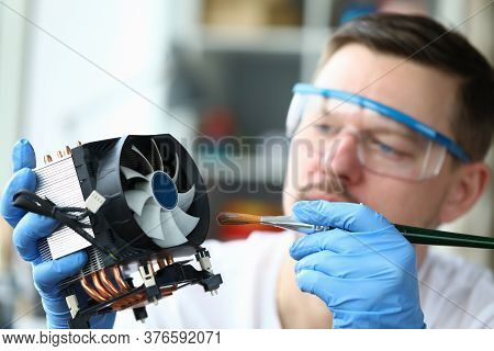 Close-up Of Concentrated Man In Protective Glasses Cleaning Detail On Pc. Brunette Middle-aged Male
