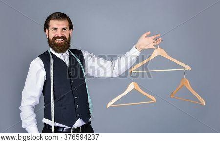 Best Design. Portrait Of Man Holding Hanger. Tailor Man Use Tape Measure. Professional Male Sartor W