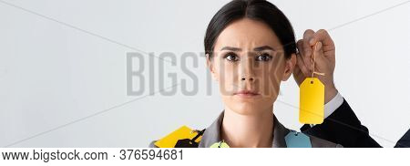 Horizontal Crop Of Businessman Putting Label On Beautiful Businesswoman Isolated On White, Gender In