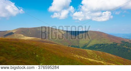 Hills And Meadows Under The Blue Sky With Clouds. Hills And Meadows Under The Blue Sky With Clouds.