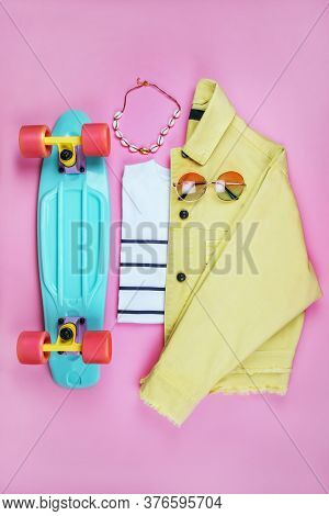 Summer Fashion Flatlay With White Striped T-shirt, Bright Yellow Denim Jacket, Turquoise Penny Skate