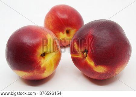 Three Nectarines On White Background. Nectarine Fruit Isolated On White Background