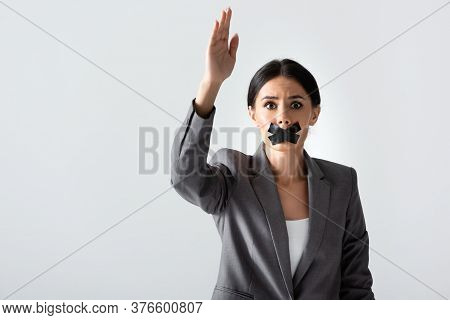 Businesswoman With Scotch Tape On Mouth Raising Hand And Looking At Camera Isolated On White, Gender