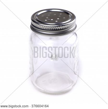 Empty Glass Spice Jar Isolated On A White Background. Cooking Utensil. Kitchen Ware. Kitchen Utensil
