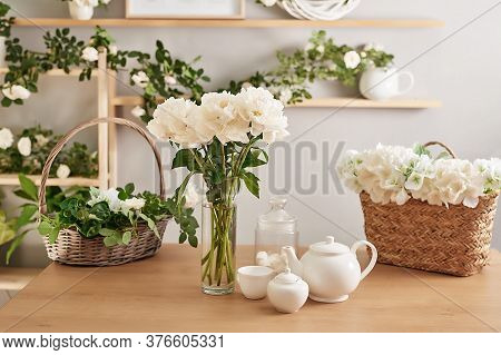 Festive Table Setting. Tea Set And Flowers On Table. Bouquet Of Roses And Peonies. Mother's Day Gree