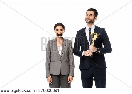 Businessman Holding Trophy Near Businesswoman With Duct Tape On Mouth Isolated On White, Gender Ineq