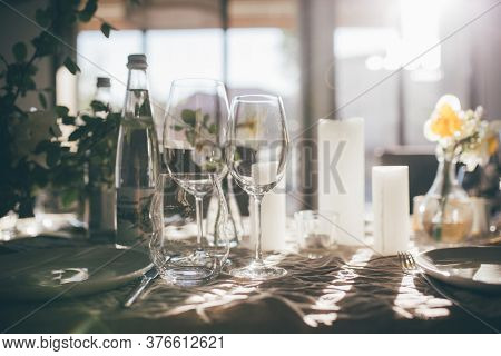Dishware With Floral Decoration On Table At Sunset. Wedding Festive Interior, Table Decorations, Flo