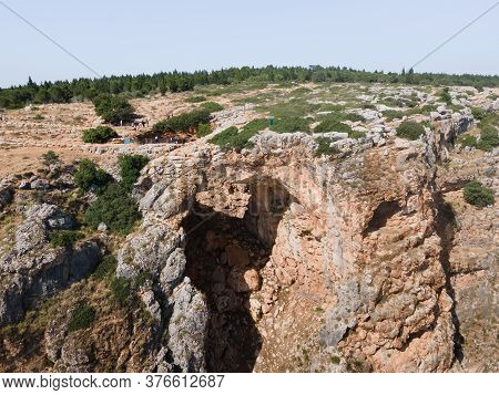 The Keshet Cave - Ancient Natural Limestone Arch Spanning The Remains Of A Shallow Cave With Sweepin