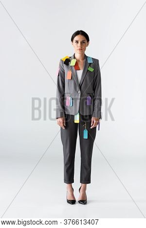 Businesswoman With Labels On Formal Wear Standing On White, Gender Inequality Concept