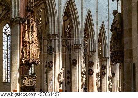 View Of The Filigree Wooden Nave Pulpit And Center Aisle In The Minster Of Ulm