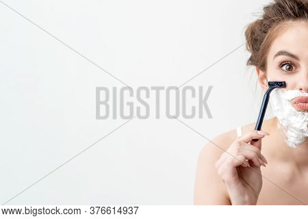 Beautiful Young Caucasian Woman Shaving Her Face By Two Razors On White Background. Pretty Woman Wit