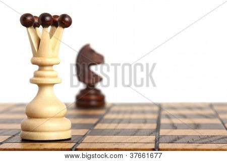 Queen And Knight On Chessboard