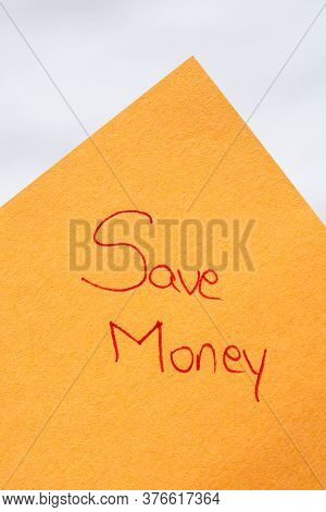 Save Money Handwriting Text Close Up Isolated On Orange Paper With Copy Space. Writing Text On Memo