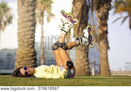 Young Beautiful Athletic Young Roller Skate Woman With Blue Hair And Retro Sunglasses, Rollerblading