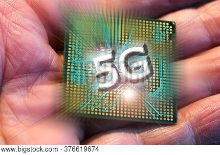 5g Word On Microprocessor In A Man Hand. Concept Of 5g Network Communication On Modern Circuits, Hig