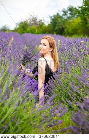 Woman Walks With Bouquet In Lavander Field In Czech Republic