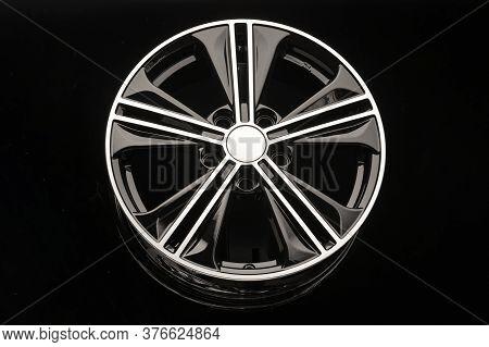 Black Alloy Wheel On Dark Background Close Up