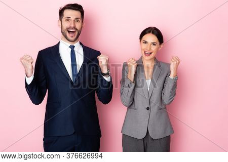 Excited Businessman And Businesswoman Celebrating Triumph On Pink, Gender Equality Concept