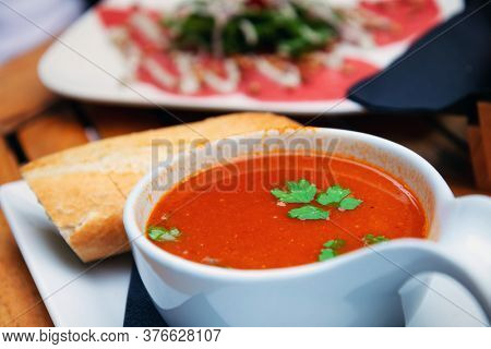 Healthy vegan cold soup prepared with beetroots and vegetables perfect as dietetic summer dish