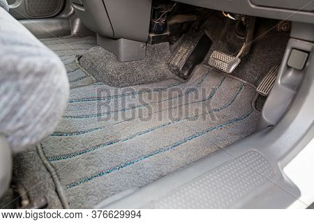 Gray Textile Car Mat In The Interior Of A Japanese Car With Three Pedals - Gas, Brake And Clutch In