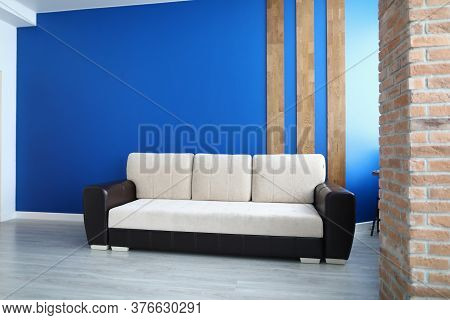 Close-up Of Comfy Sofa For Office Or Living Room. Stylish White Colour And Black Insert. Bright Blue