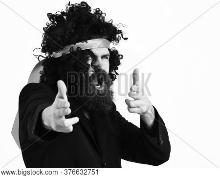 Caucasian Hipster In Suit And Black Curly Tie-tied Afro Wig