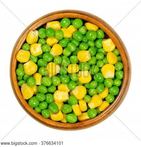 Green Peas And Corn In Wooden Bowl. Mixed Vegetables. Seeds Of Pod Fruit Pisum Sativum And Blanched