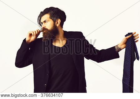 Brutal Caucasian Hipster In Black Suit Holding Ties