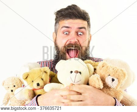 Man With Astonished Face Holds Pile Of Soft Toys