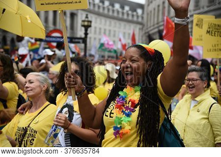London, United Kingdom, July 6 2019: Happy Lgbt People And Supporters Wearing Colourful Costumes Wit