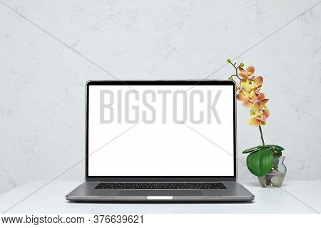 Laptop With Blank Empty Screen On White Table. Feminine Interior. Mockup. Home Workspace.