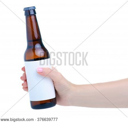 Hand Holding Glass Bottle Of Beer On White Background Isolation