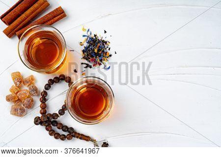 Cup Of Tea With Cinnamon Sticks On Table