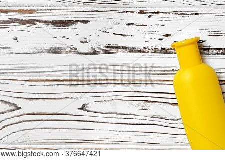 Sunblock Cream Cosmetic Bottles On Wooden Surface