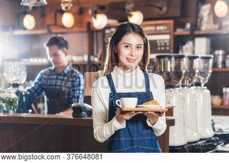 Asian Coffee Shop Owner Serving Bakery Cake And Coffee Cup To Customer In Coffee Shop, Small Busines