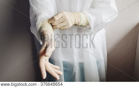 Cropped Shot Of Healthcare Worker Wearing Ppe Suit For Working In Hospital During Covid-19 Pandemic.