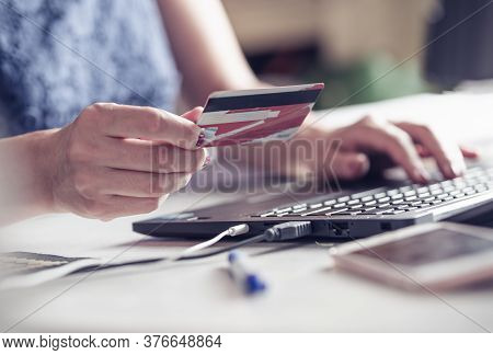 Woman Buying Online With Credit Card. Online Shopping. Woman Shopping Online. Female Hands Holding C