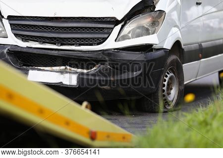 Broken Minibus Stands On Road After An Accident. Car Insurance Concept