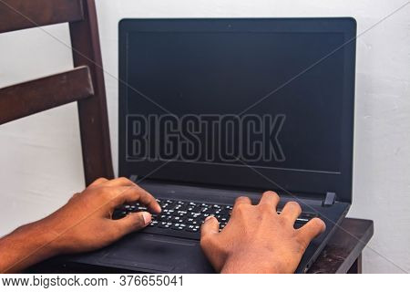 Work From Home - Man's Hands Using Laptop With Screen On Desk In Home Interior. Mockup Style Image O