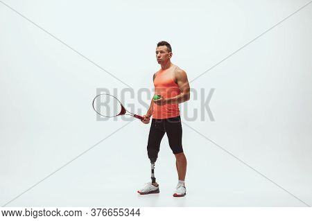 Athlete With Disabilities Or Amputee Isolated On White Studio Background. Professional Male Tennis P